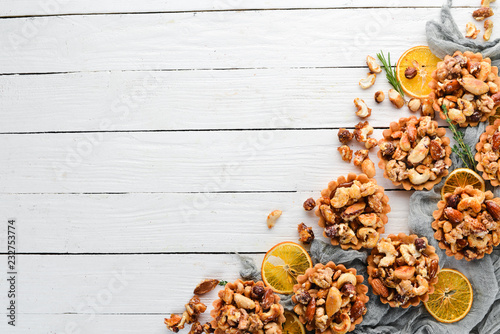 fototapeta na ścianę Cookies with caramelized nuts. On a wooden background. Top view. Free copy space.