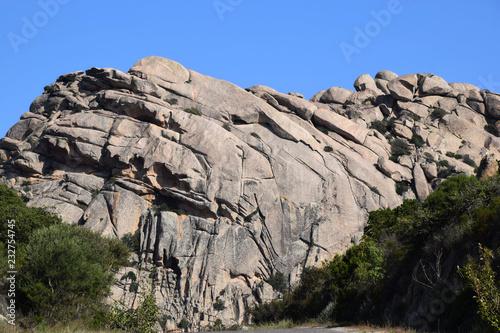 macro shot of big granite rock, rocky granitic massif landscape impressions in north sardinia in autumn as a rock background