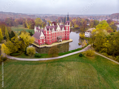 fototapeta na ścianę Wonderful picturesque Scene in the Park. Muskau Castle with sky in autumn. Schloss of Saxony, Germany. UNESCO World Heritage Site. Beautiful castle.