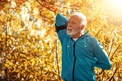 Senior man stretching in the park
