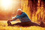 Senior man stretching in the park - 232763378