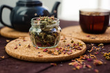Dry Herbal tea in a glass jar on a wooden table. selective focus. - 232767931