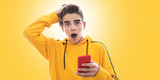 young teenager with mobile phone and isolated expression - 232770983