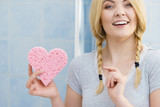 Blonde woman in braids holding heart - 232771596