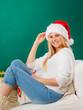 Santa christmas woman relaxing on sofa