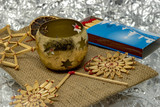 Golden Christmas decoration with straw stars, candlesticks and matches with shiny silver background - 232771943
