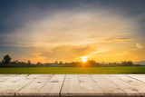 Rice field sunset and Empty wood table for product display and montage. - 232775971