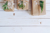 Homemade wrapped christmas gift box presents on a wood table background. - 232775990