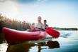 Leinwanddruck Bild - Happy couple rowing kayak on lake