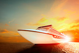 luxury cruising ship over sea with sunset sky background - 232780314