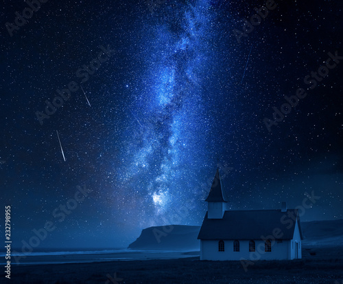 Leinwandbild Motiv Milky way over small church on the beach, Iceland