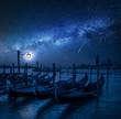 Quadro Swinging gondolas in Venice at night with stars, Italy