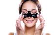Leinwanddruck Bild - Beautiful woman applying coal mask