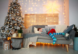 Little boy sleeping on bed at home on Christmas Eve - 232820182