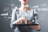 Growth with business woman using a tablet computer - 232823555