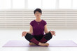 Yoga, harmony, people concept - Middle aged woman sitting in lotus position
