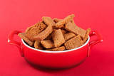 hot snacks concept, in a red pan crackers with spices, on a red background, side view - 232837749