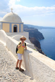 Portrait of young boy in hat on the streets of Oia, Santorini - 232840195