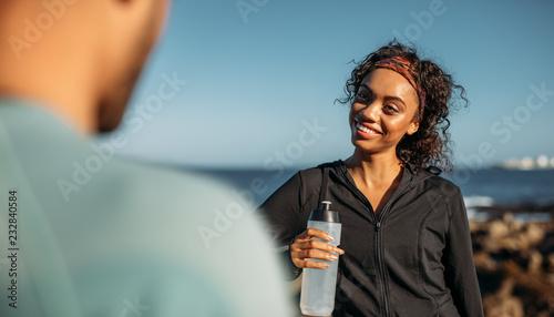 Leinwanddruck Bild Woman relaxing after workout