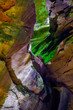 Colorful sandstone rocks and cliffs with live ferns in the deep gorges and rocky valley