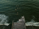 Aerial drone image of a hurricane Storm damaged Fishing pier on the Atlantic Ocean off the South Carolina Coast
