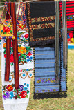 Background with traditional Romanian bags, belts and material embroidered - 232863713