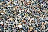 A lot of coloured pebbles on a shore for a background of natural material - 232872141