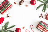 Christmas composition. Christmas gifts, fir tree branches, decorations on white background. Flat lay, top view, copy space - 232872959