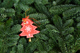 Christmas background with fresh evergreen tree banches and red christmas tree decoration. - 232875712
