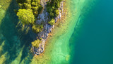 Aerial view on the lake and forest. Natural landscape from drone. Aerial landscape from air in the Switzerland