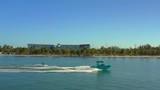 Aerial video sking boat pulling skier - 232875750
