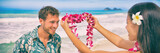 Hawaii woman giving lei flower garland welcoming tourist man on Hawaiian beach. Portrait of a Polynesian culture tradition of giving a flower necklace to a guest as a welcome gesture. Banner panorama. - 232889192