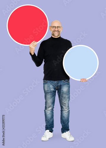 Foto Murales Smiling man holding a blank circle icons