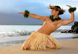 Male Hula Dancer performs on the beach a traditional masculine hula.