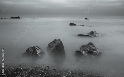 Foto Murales Long exposure, rocks by the sea