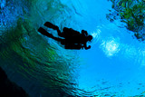 Silhouette of a Side Mount diver at a Florida Spring - 232903996