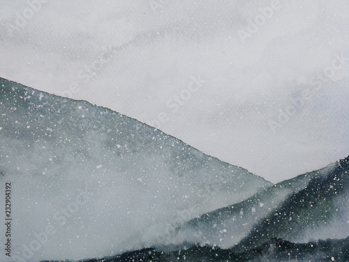 watercolor painting asian art mountains covered snow fall with fog in winter season. © atichat