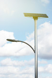 solar battery and lamp against the sky, alternative energy, toned - 232907736