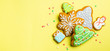 Christmas cookies on bright yellow background