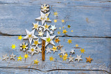 Merry Christmas: Background, decoration with stars on old blue wooden board :)  - 232919187