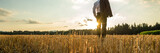 Wide view image of businessman standing in sawn golden field - 232920729