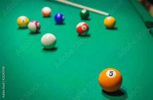 Billiard balls on pool green table