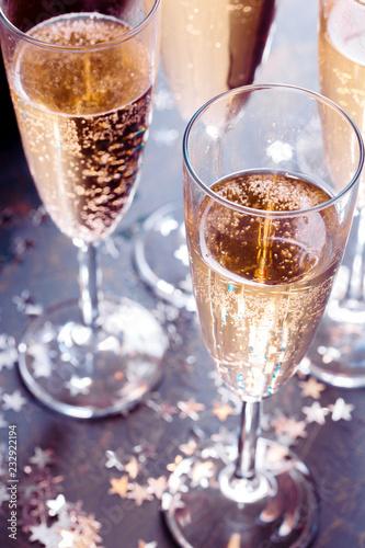 Leinwanddruck Bild Glasses of champagne on the table