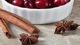 Holiday cooking spices, star anise, cinnamon sticks and cranberries - 232926985