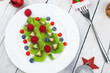 Leinwandbild Motiv Kiwi Christmas tree - fun food idea for kids party or breakfast