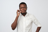 Handsome african man showing a sign of closing mouth - 232944790
