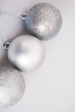 White Christmas background. Glossy silver and glitter decoration balls. Minimalist style. Copyspace for text, overhead - 232947310