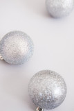 White Christmas background. Glossy silver and glitter decoration balls. Minimalist style. Copyspace for text, overhead - 232947330