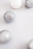 White Christmas background. Glossy silver and glitter decoration balls. Minimalist style. Copyspace for text, overhead - 232947535