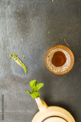 close up of moroccan traditional tea glass on a wooden plate